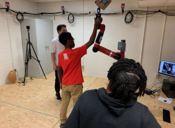 Students from Imhotep Academy experiencing Sawyer the robot.