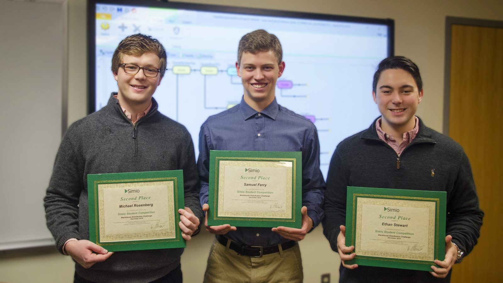 Michael Rosenberg, Smauel Ferry, and Ethan Stewart receive their Simio Certifiactes