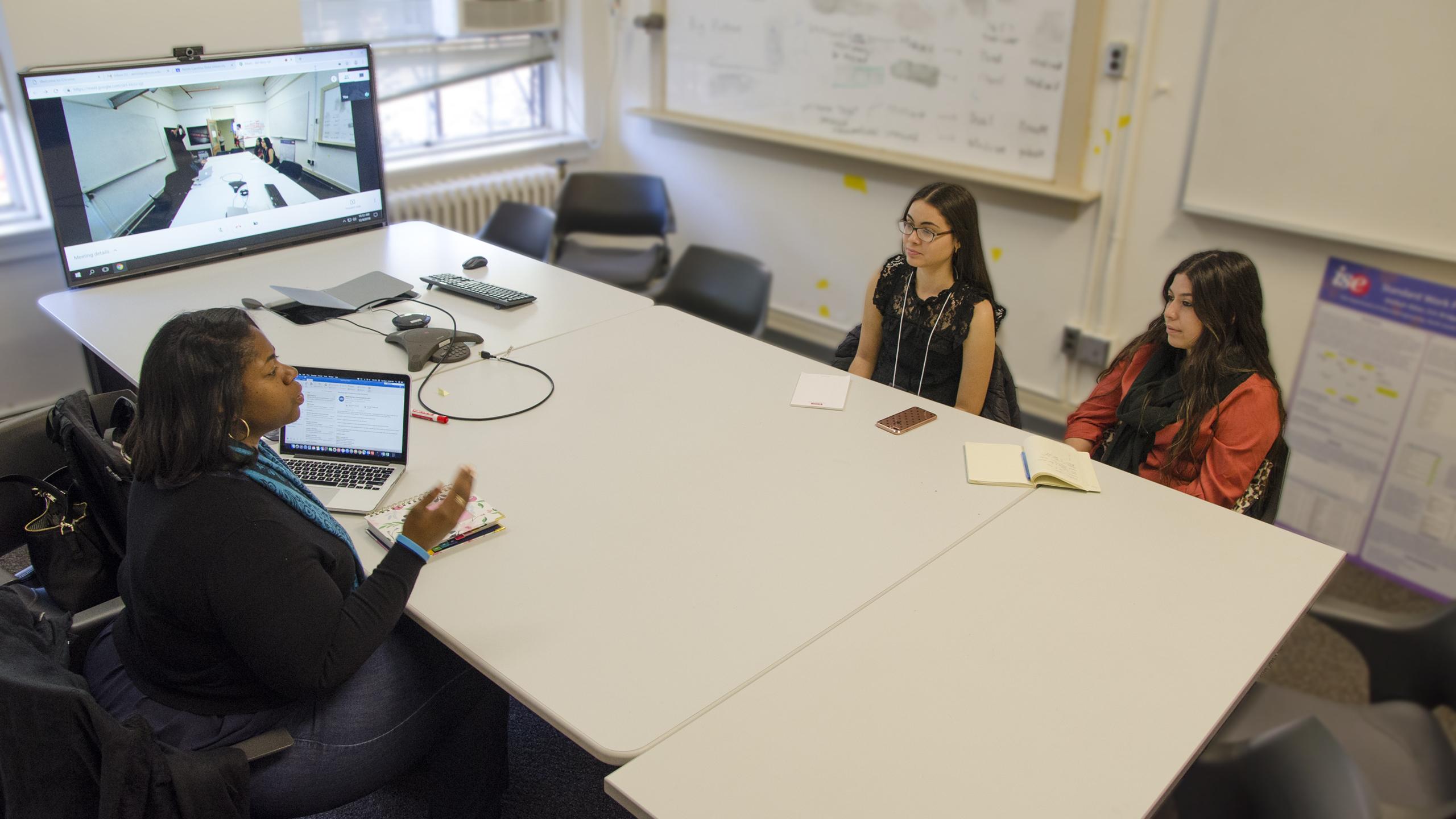 Karen Hicklin coaches students on their interviewing skills