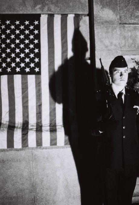 Charles Blum standing guard at the Memorial Belltower