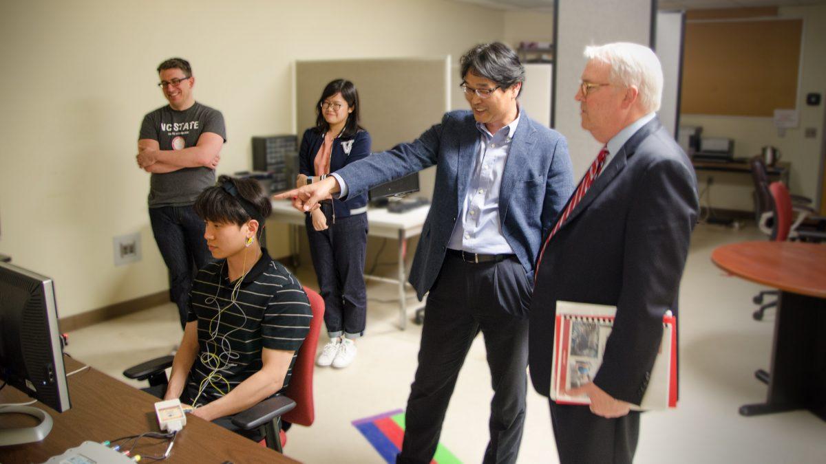 Dr.Nam presents to Chancellor Woodson.
