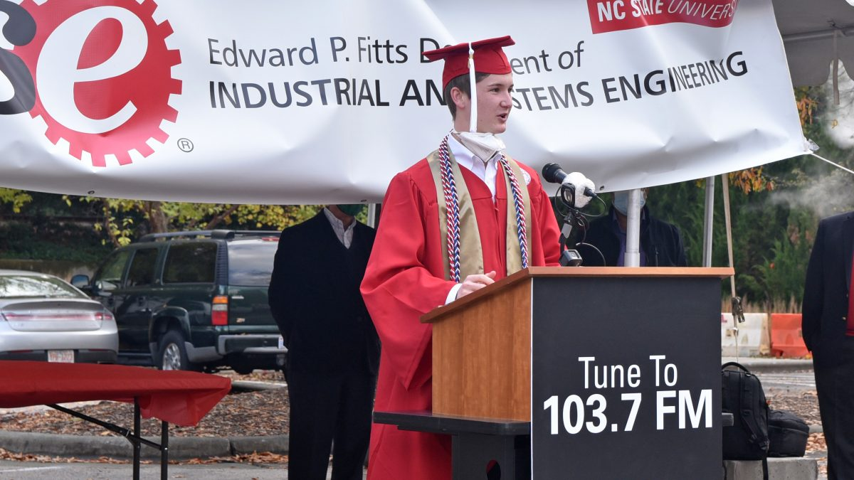 A male student gives remarks at the podium.