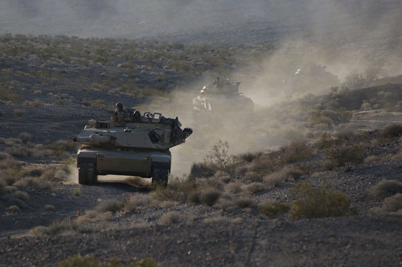 Soldiers engage the enemy during a Decisive Action Rotation at the NTC in Fort Irwin, California