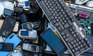 A pile of old and broken electronics