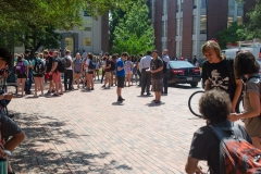 Students, staff and faculty standing outside of Daniels Hall waiting for the solar eclipse